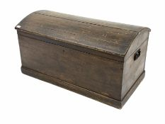 Late 19th century scumbled pine dome top trunk with iron carry handle to each end