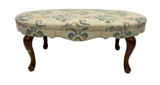 Upholstered oval footstool raised on walnut cabriole supports 116cm x 63cm