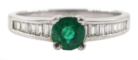 Platinum round emerald ring