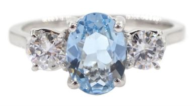 18ct white gold three stone oval aquamarine and round brilliant cut diamond ring