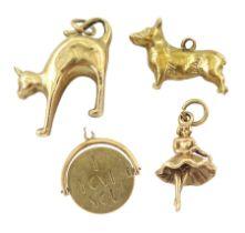 Four 9ct gold charms including corgi