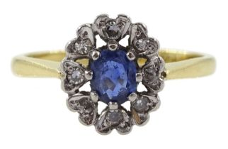 Gold oval sapphire and diamond cluster ring