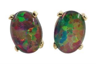 Pair of gold oval opal stud earrings