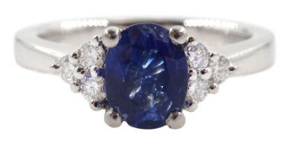 Platinum oval sapphire and six stone diamond ring