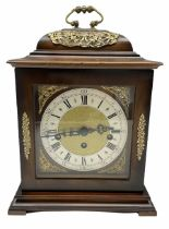 A 20th century three train mantle clock in the style of an 18th century bracket clock