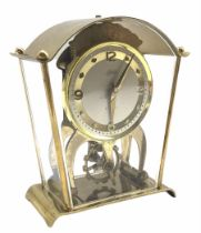 A vintage Schatz & Sohne German eight-day mantle clock with visible oscillating balance