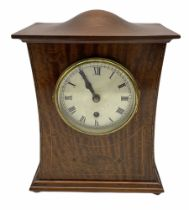 A twentieth century mahogany mantle clock with a waisted case in the art Nuovo style