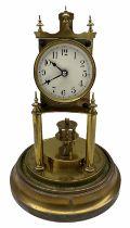 An early 20th century German torsion pendulum clock manufactured by Gustav Becker