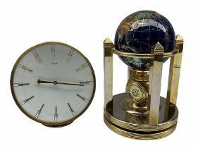 A globe desk clock with two battery driven clock dials