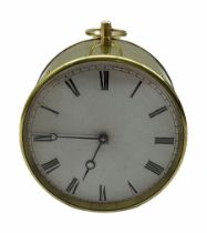 Mid-19th century French circular brass cased portable timepiece on three turned feet with circular c