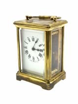 A late 19th century French Corniche cased 8-day timepiece carriage clock with a jewelled lever platf