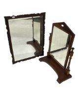 19th century dressing swing mirror with arched pediment over turned and fluted supports on a shaped