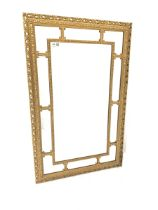 Ornate gilt framed wall mirror with beaded border and scrolled acanthus leaf decoration to frame 53