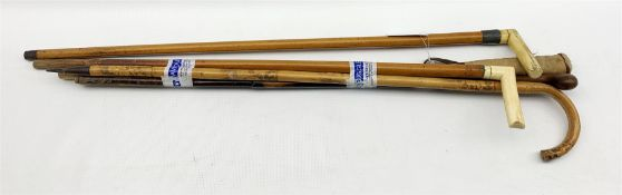 Two horn handled malacca walking sticks and various others