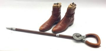 Pair of tan leather boots and wooden tree inserts