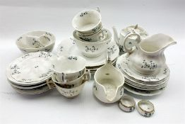 19th century French tea set decorated with floral sprigs 33 pieces