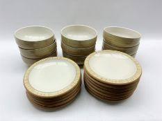 Nine Denby Caramel Stripes pattern bowls and twelve matching plates