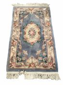 Chinese washed wool ground rug with floral design enclosed by a floral boarder (176cm x 91cm)