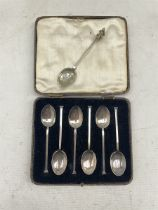 Set of six silver seal top coffee spoons and a silver fox hound tea spoon 1932