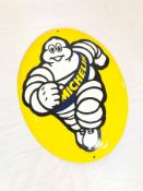 Oval enamel sign with Michelin man logo