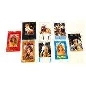 8 Playboy calendars and a magazine
