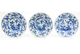series of three 18th Cent. Chinese plates in porcelain with blue-white garden decor Reeks van drie