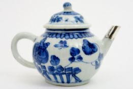 18th Cent. Kang Xi tea pot in porcelain with blue-white flower and butterfly decor and with silver