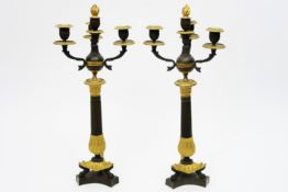 pair of antique, probably French Empire style candelabras partially dark brown patinated partially