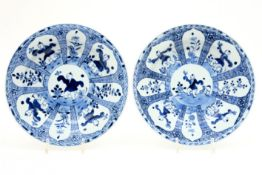 pair of 17th/18th Cent. Kang Xi Chinese plates in porcelain with blue-white decor with 'fools'