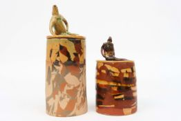 two cylindrical small lidded jars (with male figure) in ceramic signed José Vermeersch||VERMEERSCH J