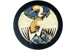 framed round, antique Chinese embroidery, part of a dress, with the representation of a phoenix   