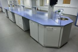 Köttermann multi-station lab workbench, approx 7m in length, with one sink unit, glass over counter