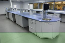 Köttermann multi-station lab workbench, approx 7m in length, with two sink units, glass over