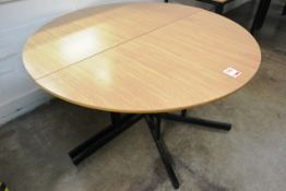 Two section light oak effect circular table, approx total dia 1500mm