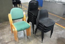 Fourteen various stacking chairs