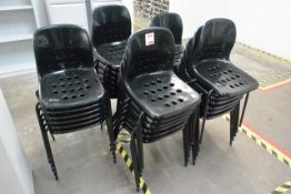 Thirty black plastic stacking chairs