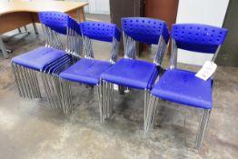 Twenty nine various stacking chairs
