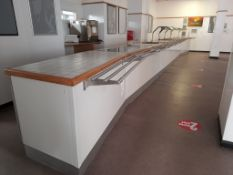 Canteen servery with heated gantry, hot plates, plate dispensers and warming cupboards, as lotted. A