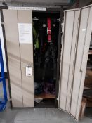 Double door cupboard containing PPE including harnesses, lanyards, hard hats, chain blocks etc.,