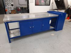 1 - Workbench, with fitted 3-door cupboard and blue metal double door cupboard, as lotted