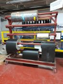 Mobile fabricated rack (currently utilised for rolls of belt conveyor), as lotted. (Contents