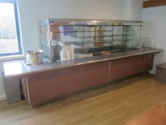 Tiled top serving counter with glass shelf chiller display, under canopy lighting, soup warmer,