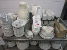 Quantity of assorted chinaware including plates, cups, saucers, jugs, serving bowls, etc.,