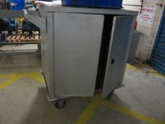 Mobile cabinet and contents of assorted lifting chains, lever hoists, beam clamps etc. (condition