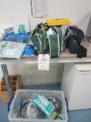 Assorted First Aid equipment including helmets, full overalls, First Aid bag, arm bands,