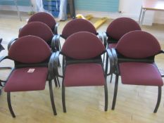 Seven black frame upholstered meeting armed chairs