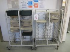 Two multi shelf mobile tray trollies with assorted trays
