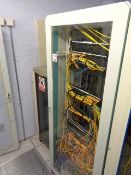 Two glass fronted cabinets and contents to include various rack switches