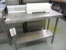 Two stainless steel preparation table with splash back, undershelf 1130mm x 500mm