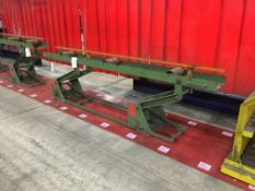A steel height adjustable roller conveyor 3m long